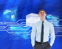 Composite image of serious businessman standing with hands in pockets Royalty Free Stock Photo
