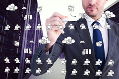 Composite image of serious businessman writing with marker Royalty Free Stock Image