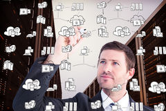 Composite image of serious businessman writing with marker Stock Photos