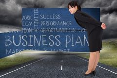 Composite image of serious businesswoman bending Royalty Free Stock Image
