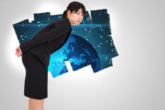 Composite image of serious businesswoman bending Stock Photography