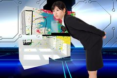 Composite image of serious businesswoman bending Stock Image