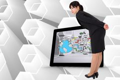 Composite image of serious businesswoman bending Royalty Free Stock Photos
