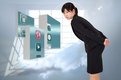 Composite image of serious businesswoman bending Stock Photo