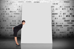 Composite image of serious businesswoman bending Stock Images
