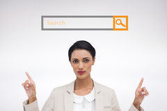 Composite image of serious businesswoman with hands up Royalty Free Stock Photo