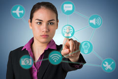 Composite image of serious businesswoman pointing Stock Photos