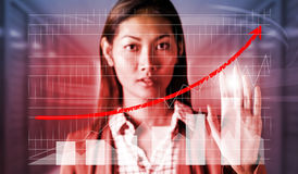 Composite image of serious businesswoman showing her hand Royalty Free Stock Image