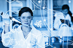 Composite image of serious chemist working with white dna helix diagram inteface Stock Photography