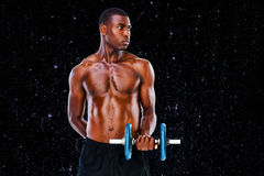 Composite image of serious fit shirtless young man lifting dumbbell Royalty Free Stock Photos