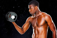 Composite image of serious fit shirtless young man lifting dumbbell Stock Image