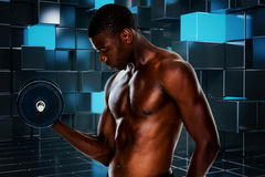Composite image of serious fit shirtless young man lifting dumbbell Stock Photos