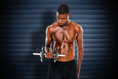 Composite image of serious fit shirtless young man lifting dumbbell Stock Photography