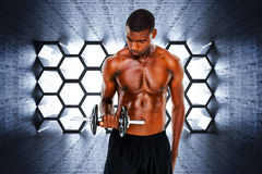 Composite image of serious fit shirtless young man lifting dumbbell Stock Photo
