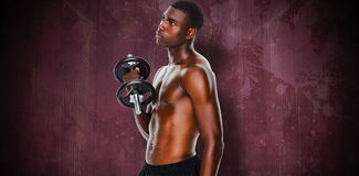 Composite image of serious fit shirtless young man lifting dumbbell Royalty Free Stock Photography
