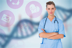 Composite image of serious nurse looking at camera with arms crossed Royalty Free Stock Images