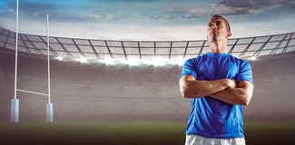 Composite image of serious rugby player looking away with arms crossed Royalty Free Stock Photography