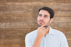 Composite image of serious thinking man looking up Royalty Free Stock Photography