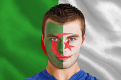 Composite image of serious young algeria fan with facepaint Royalty Free Stock Photography