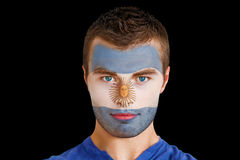 Composite image of serious young argentina fan with facepaint Royalty Free Stock Photos