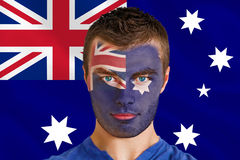 Composite image of serious young australia fan with facepaint Stock Image