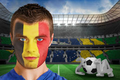 Composite image of serious young belgium fan with face paint Stock Image