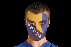 Composite image of serious young bosnian fan with facepaint Royalty Free Stock Photo