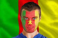 Composite image of serious young cameroon fan with facepaint Stock Photography