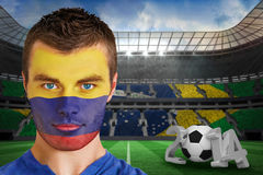 Composite image of serious young colombia fan with face paint Stock Photos