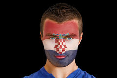 Composite image of serious young croatia fan with facepaint Stock Photography