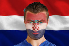 Composite image of serious young croatia fan with facepaint Stock Photos