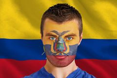 Composite image of serious young ecuador fan with facepaint Royalty Free Stock Image