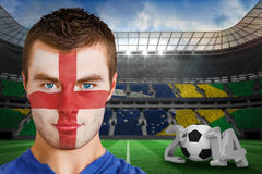 Composite image of serious young england fan with facepaint Stock Photo