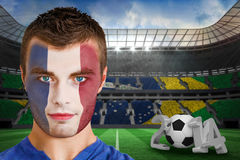 Composite image of serious young france fan with face paint Stock Image