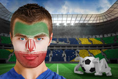 Composite image of serious young ivory coast fan with face paint Royalty Free Stock Photo