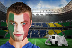 Composite image of serious young ivory coast fan with face paint Royalty Free Stock Photos