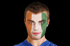 Composite image of serious young ivory coast fan with facepaint Royalty Free Stock Photo