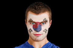 Composite image of serious young korea republic fan with facepaint Royalty Free Stock Photos