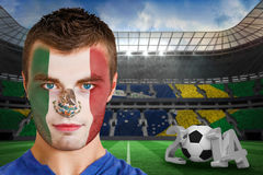 Composite image of serious young mexico fan with face paint Stock Photography