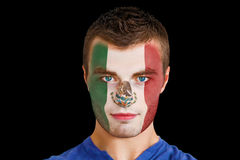 Composite image of serious young mexico fan with facepaint Royalty Free Stock Photos