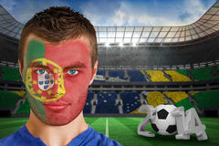Composite image of serious young portuguese fan wi Stock Photos