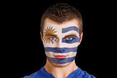 Composite image of serious young uruguay fan with facepaint Royalty Free Stock Image