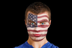 Composite image of serious young usa fan with facepaint Stock Photos