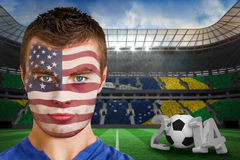 Composite image of serious young usa fan with facepaint Royalty Free Stock Photography