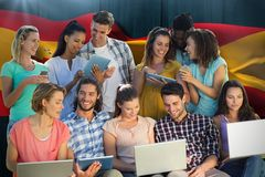Composite image of several students using electronic devices royalty free stock photos