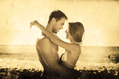 Composite image of sexy couple embracing Royalty Free Stock Photo