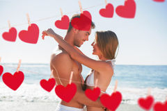 Composite image of sexy couple embracing Stock Image