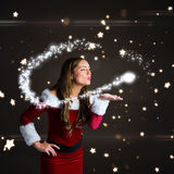 Composite image of santa girl blowing a kiss Royalty Free Stock Photography
