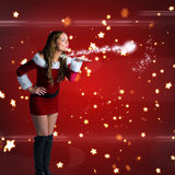 Composite image of santa girl blowing a kiss Stock Image