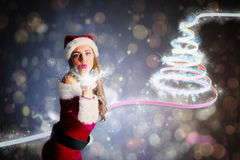 Composite image of santa girl blowing a kiss Royalty Free Stock Images